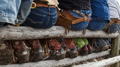 Picture of cowboy butts and boots, Cowboys and cowgirls setting on a rail fence taking a break, cowboy, western, spurs, large format, cowgirl, western lifestyle, buckaroo, ranch, museum, fine art, pri