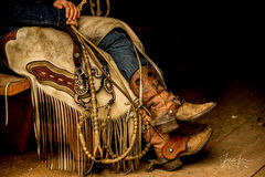 Cowgirl photo picturing a Wyoming cowgirl taking a break from roping cattle, cowboy, western, Peter Lik, cowgirl, ranch, spurs, bridle, horses, museum, fine art, print, jess lee, artist, photographer,