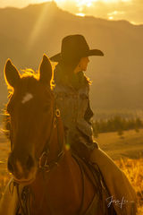Wyoming Cowgirl looking back into the autumn afternoon.