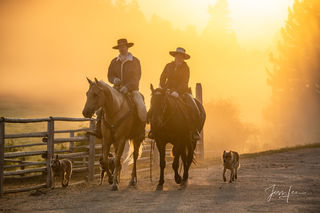 Cowboy and Cowgirl Riding at Sunrise