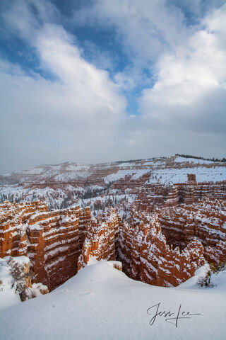 Standing at the edge of Bryce Canyon covered in fresh powder.