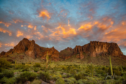 Cotton candy clouds hanging above canyon in Monument Valley, Arizona.