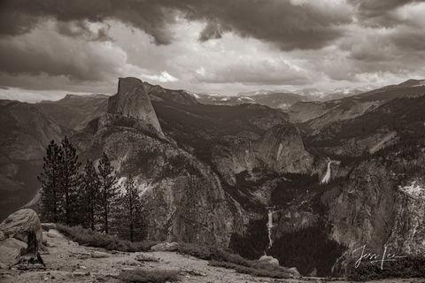 Black and white photo of Yosemite's landscape and Yosemite Falls.