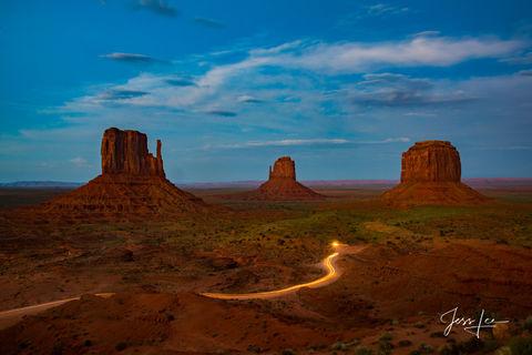 Streak of light from evening traffic in Monument Valley, Arizona.