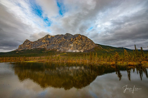 Storm brewing over Alaskan mountain range. Autumn colors are in full bloom.