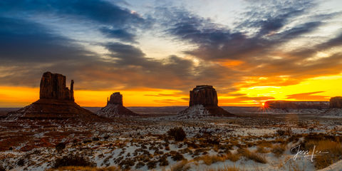Sunrise in Monument Valley casts beautiful colors over the vast landscape.