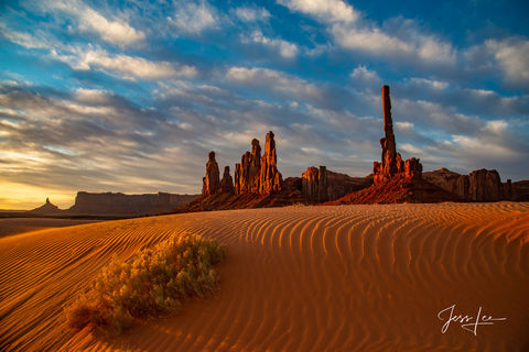 Ripples in the sand leading up to the totems in Monument Valley, Arizona.