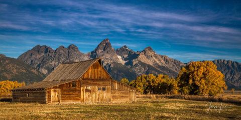photo of barn in Grand Teton National Park, Wyoming photography, Jackson Hole, landscape photographer, old barn, ranch, farm, old barn, mountain range, autumn, fall colors, blue sky, western, fine art