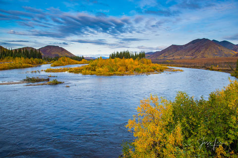 Northern Arctic river stretching into the mountain side.