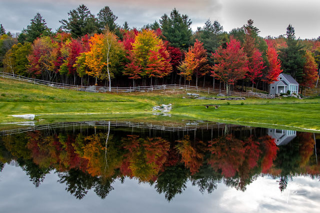 Prints of this lovely pond reflecting the colors of fall trees in New England.