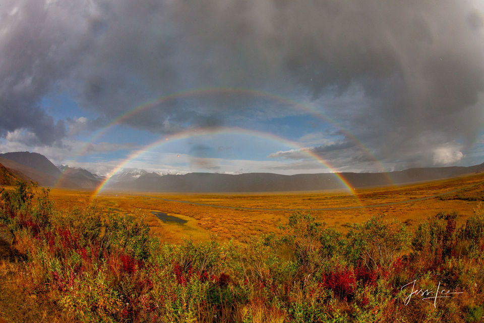 A double rainbow stretching across the Alaskan tundra.