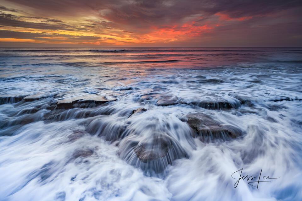 Sun rise surf and rocks