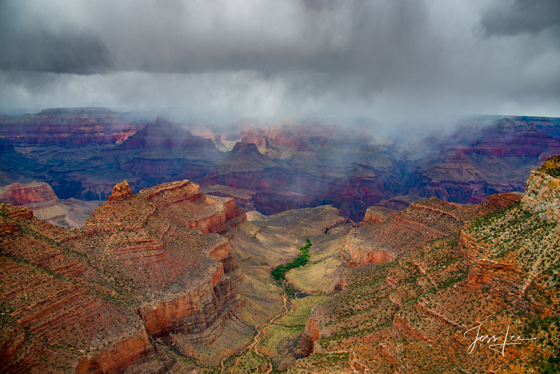 Ominous storm clouds full of rain rolling in over the Grand Canyon.