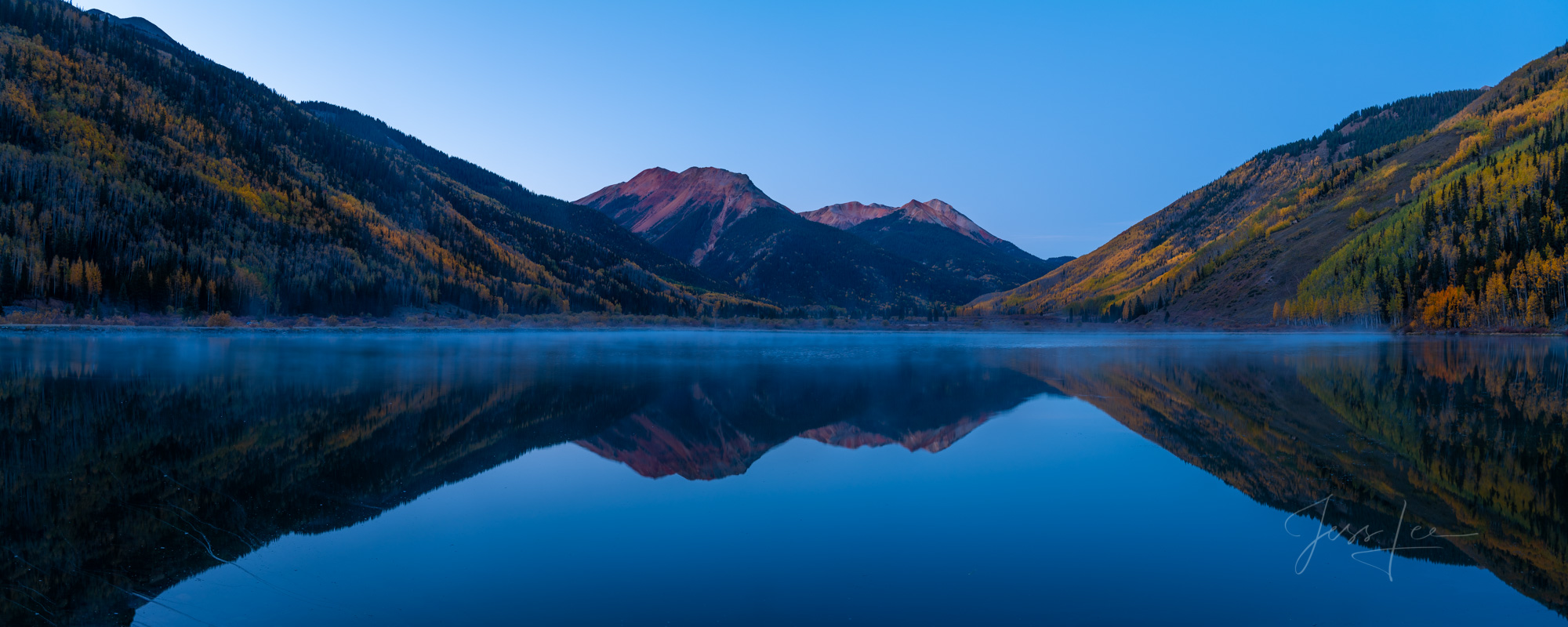 A Colorado Fall Color Panoramic Print of Crystal Lake reflection at sunrise during the peak of Autumn Color in southeast Colorado...
