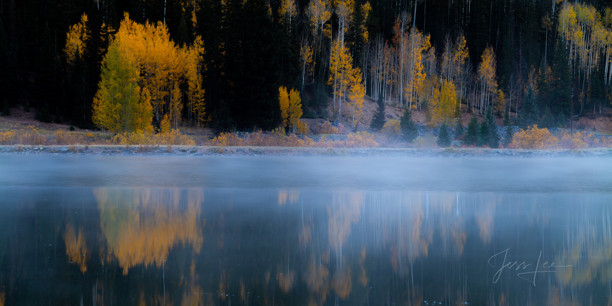 A Colorado Fall Color Print of Crystal Lake reflection at sunrise during the peak of Autumn Color in southeast Colorado. A limited...