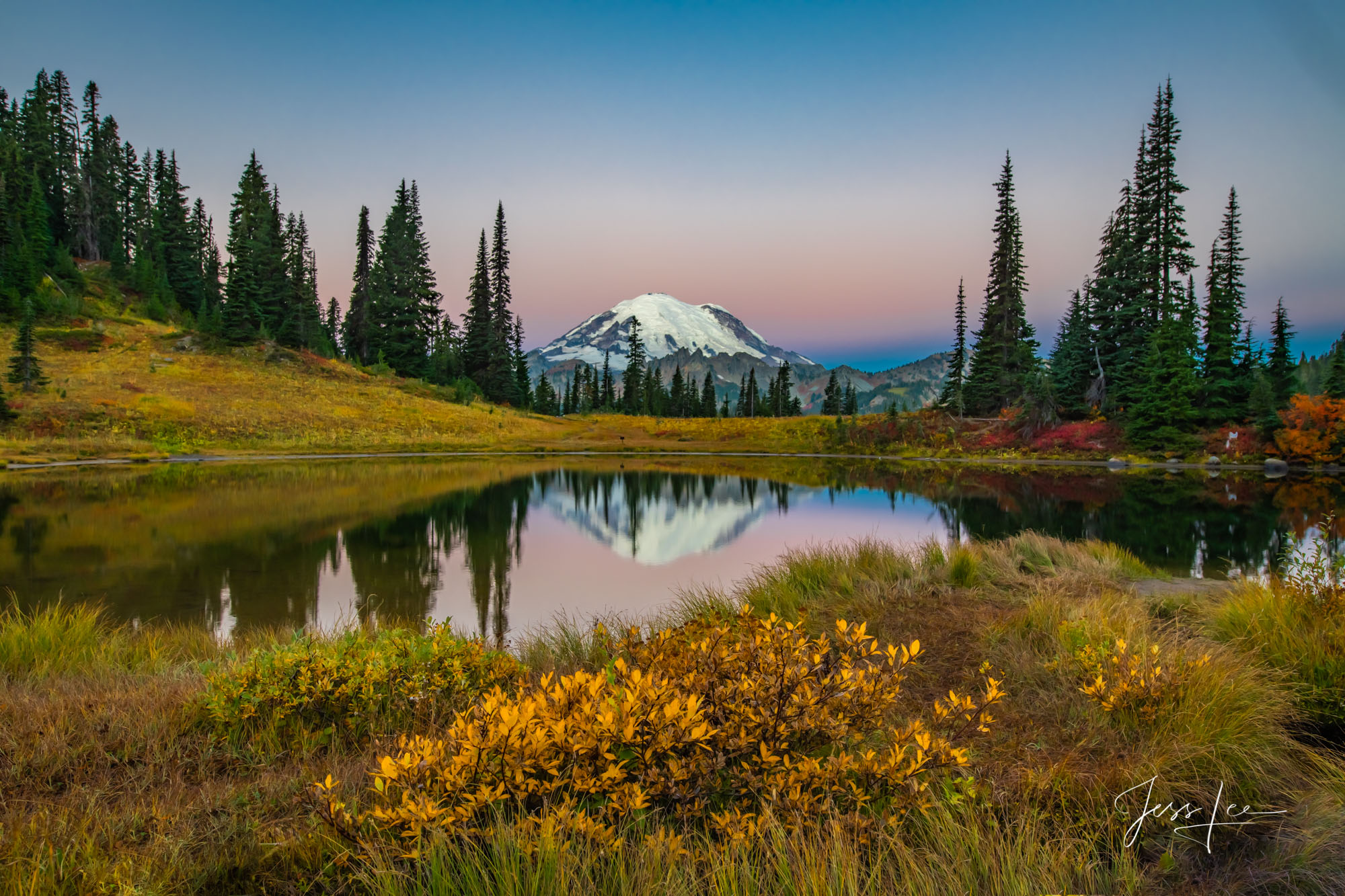 Mount Rainier at dawn reflecting in Tipsoo lake surrounded by the colors of autumn. Fine Art Limited Edition of 200 Prints.