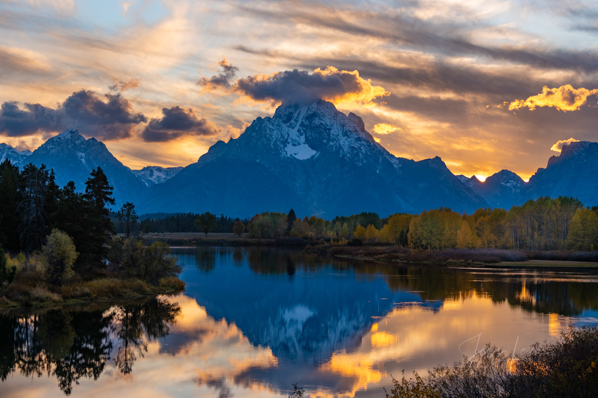 Fine Art Limited Edition of 250 prints of the sun setting behind Mt Moran with the scene reflected in the Oxbow of the Snake...