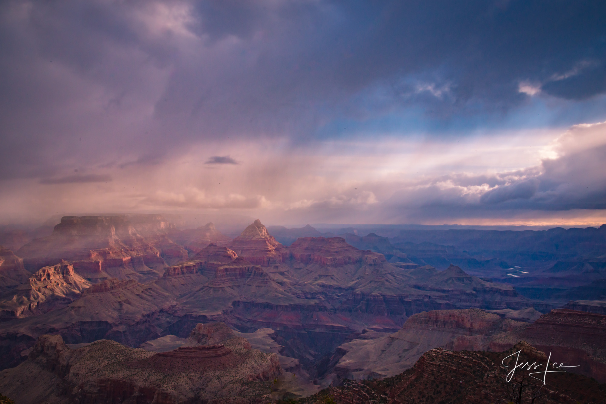 Pink and blue hues shine down onto the Grand Canyon in Arizona.
