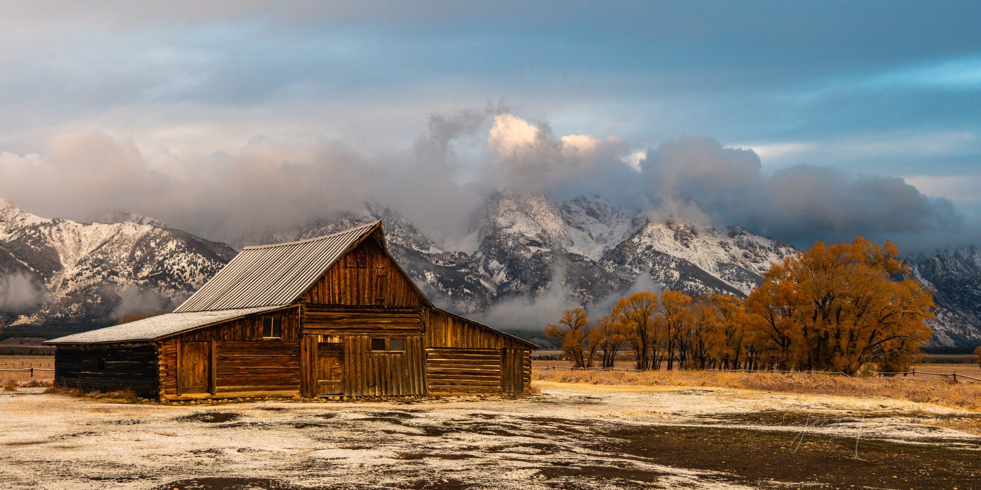 photo of barn and Grand Tetons in Wyoming, snow-covered mountains, landscape photography, landscape photo, fine art print, old farm, ranch, fall, autumn colors, winter, clouds, morning, trees, high qu, photo