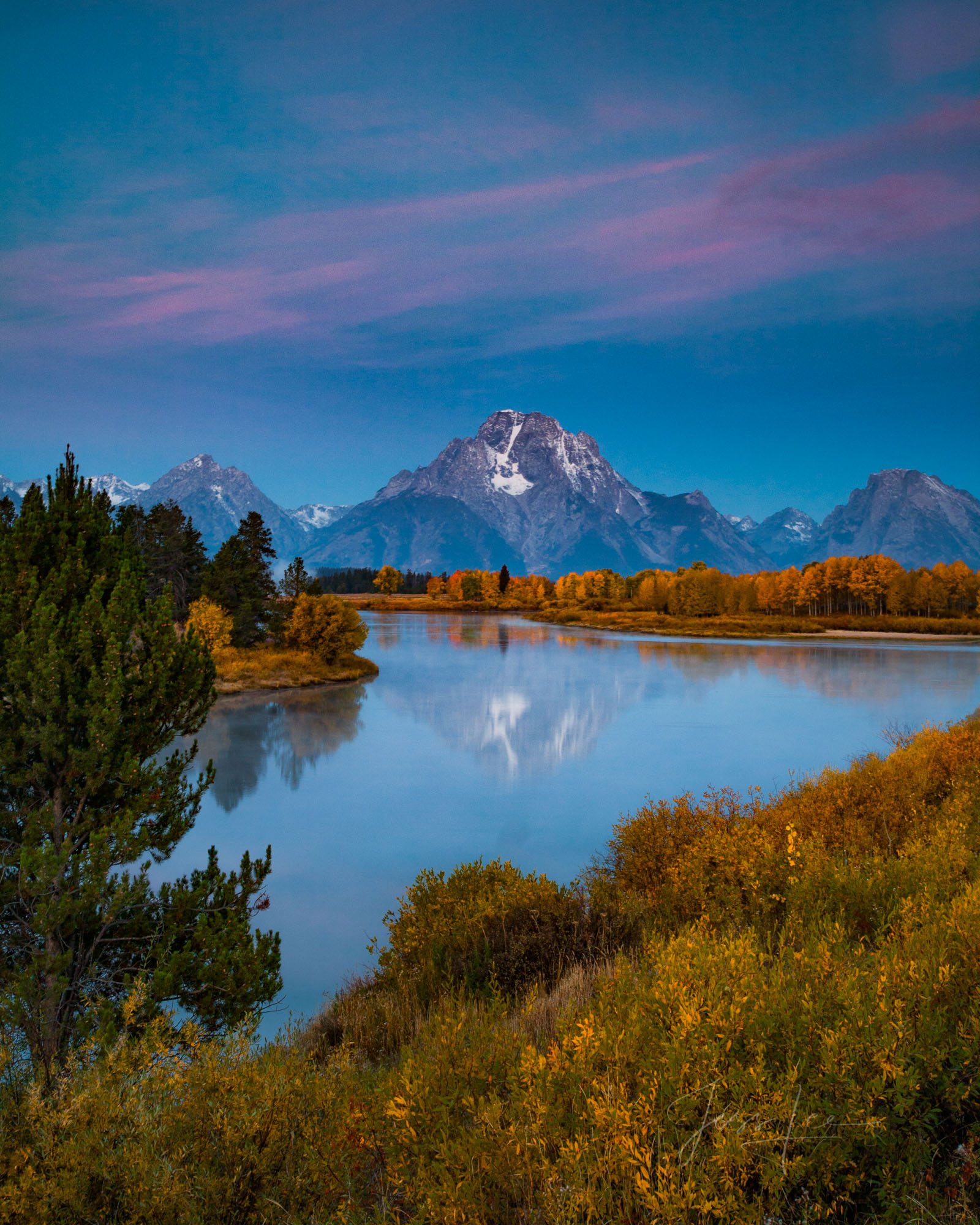 Limited Edition of 200 Grand Teton Fine Art Prints The pre dawn alpenglow brings a soft pink tone to the thin clouds over Mount...