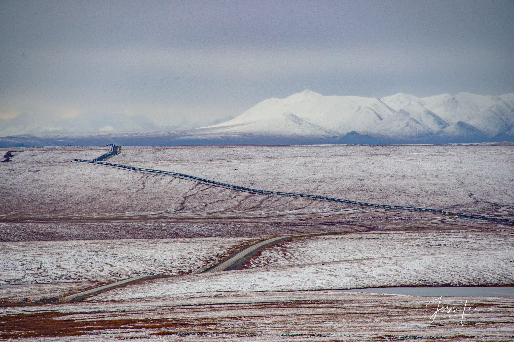 Road cutting through Arctic tundra in Alaska