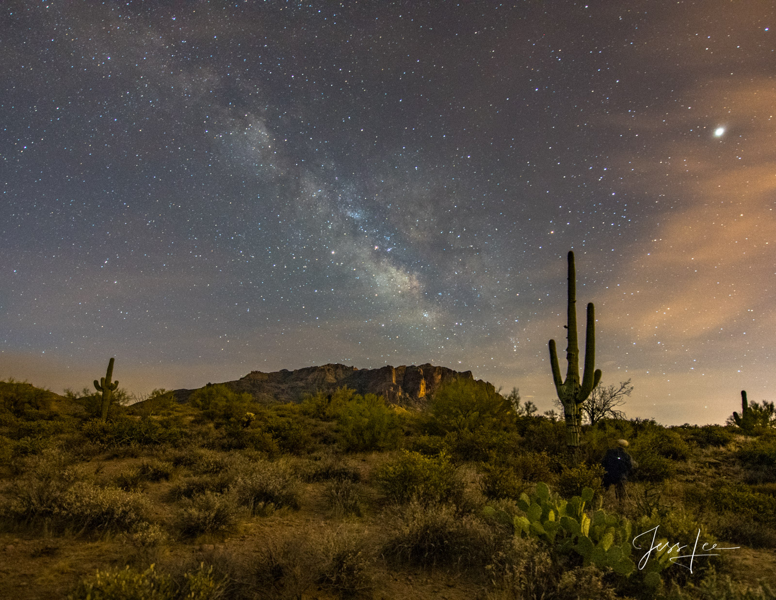 Milky Way covering the sky behind Superstition Mountains in Arizona.