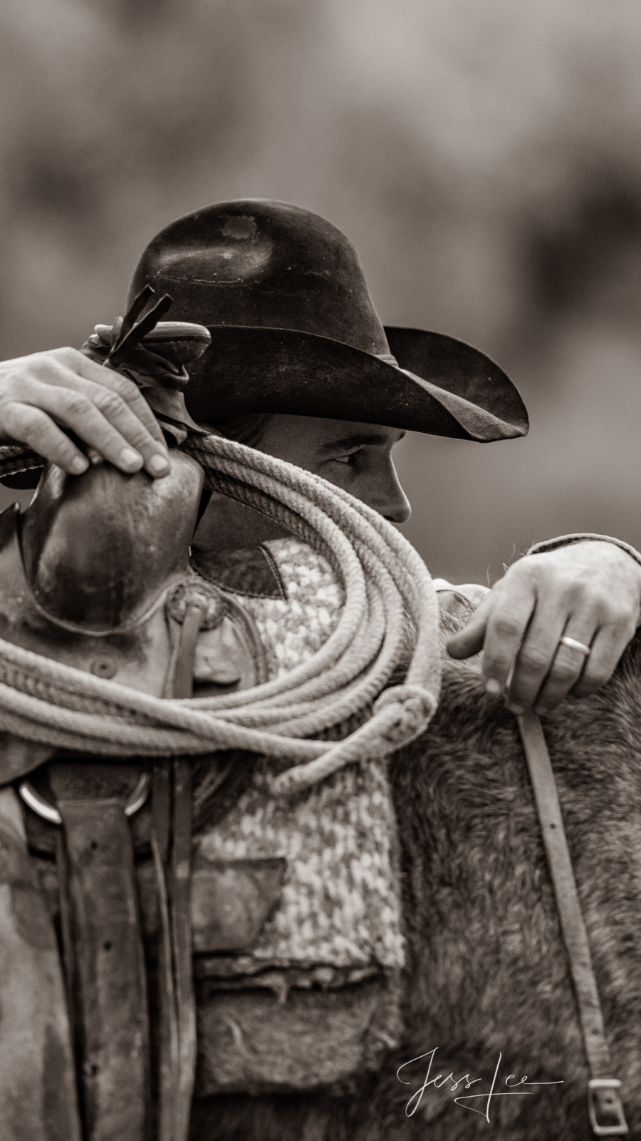Cowboy Looking over saddle